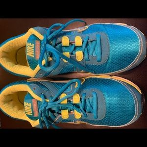 Ladies Nike Dual Fusion ST size 11. Blue/yellow